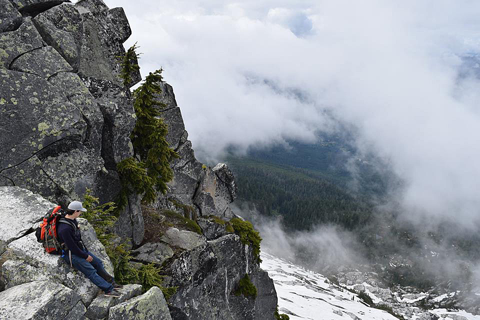 imager of Mike Guzman -Sitting on-mountain-side